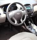 hyundai tucson 2011 black gl gasoline 4 cylinders front wheel drive automatic 79925