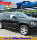 chevrolet suburban 2011 black suv lt 1500 dvd flex fuel 8 cylinders 4 wheel drive automatic with overdrive 55391