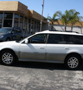subaru outback 2001 white wagon limited gasoline 4 cylinders all whee drive 5 speed manual 94063