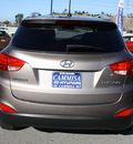 hyundai tucson 2012 brown gls gasoline 4 cylinders front wheel drive automatic 94010