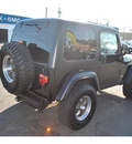 jeep wrangler 2004 black suv rubicon gasoline 6 cylinders 4 wheel drive automatic 98632