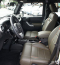 jeep wrangler unlimited 2011 black suv 70th anniversary gasoline 6 cylinders 4 wheel drive automatic 33021