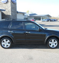 subaru forester 2009 black suv 2 5 x gasoline 4 cylinders all whee drive 5 speed manual 55811