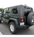 jeep wrangler unlimited 2009 green suv x gasoline 6 cylinders 4 wheel drive automatic 91761