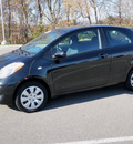 toyota yaris 2009 black hatchback gasoline 4 cylinders front wheel drive automatic 56001