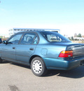 toyota corolla 1995 blue sedan dx gasoline 4 cylinders front wheel drive 5 speed manual 80504