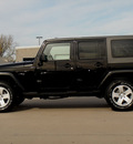 jeep wrangler unlimited 2010 black suv sahara gasoline 6 cylinders 4 wheel drive 6 speed manual 62034