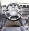 toyota rav4 1997 white suv gasoline 4 cylinders front wheel drive automatic with overdrive 80012