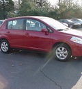 nissan versa 2009 red hatchback 1 8 sl gasoline 4 cylinders front wheel drive cont  variable trans  06019