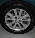 toyota corolla 2010 dk  green sedan le gasoline 4 cylinders front wheel drive automatic 91731