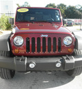 jeep wrangler unlimited 2010 burgundy suv sport gasoline 6 cylinders 4 wheel drive automatic 34731