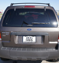 ford escape 2006 brown suv xlt gasoline 4 cylinders front wheel drive automatic with overdrive 76018