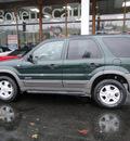 ford escape 2001 green suv xlt gasoline 6 cylinders 4 wheel drive automatic 98032