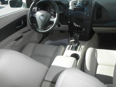 cadillac cts 2004 white sedan tan gasoline 6 cylinders rear wheel drive automatic 34731