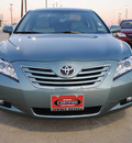 toyota camry 2009 green sedan xle gasoline 4 cylinders front wheel drive automatic 75228