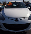 mazda mazda2 2011 crystal white sedan touring gasoline 4 cylinders front wheel drive 5 speed manual 92653