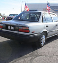 toyota corolla 1990 silver sedan deluxe gasoline 4 cylinders front wheel drive 5 speed manual 80229