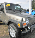 jeep wrangler 2004 gold suv rubicon gasoline 6 cylinders 4 wheel drive 5 speed manual 34474