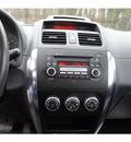 suzuki sx4 2009 red sedan sport gasoline 4 cylinders front wheel drive automatic 07724