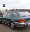 subaru impreza 1999 green wagon outback sport gasoline 4 cylinders all whee drive 4 speed manual 98632
