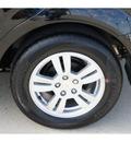 chevrolet sonic 2012 black gasoline 4 cylinders front wheel drive 6 spd auto 77090