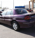 pontiac grand am 1997 purple sedan se 4 cylinders automatic 80229