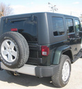 jeep wrangler unlimited 2010 green suv sahara gasoline 6 cylinders 4 wheel drive automatic with overdrive 62863