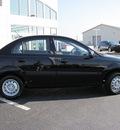kia rio 2009 black sedan gasoline 4 cylinders front wheel drive 5 speed manual 46410