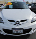 mazda mazda3 2009 crystal white hatchback s touring gasoline 4 cylinders front wheel drive automatic 92653