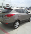 hyundai tucson 2012 gray limited gasoline 4 cylinders front wheel drive automatic 75503