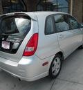 suzuki aerio 2003 silver wagon sx gasoline 4 cylinders front wheel drive manual 43228