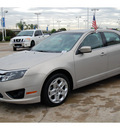 ford fusion 2010 lt  brown sedan se flex fuel 6 cylinders front wheel drive automatic with overdrive 77065