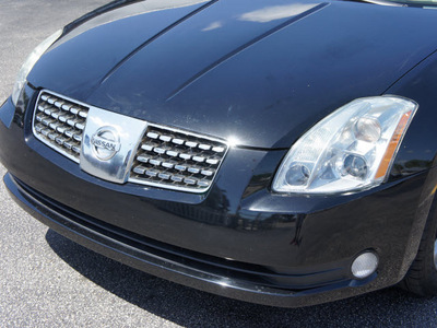 nissan maxima 2004 black sedan 3 5 sl gasoline 6 cylinders front wheel drive automatic 33021