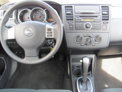 nissan versa 2010 silver hatchback gasoline 4 cylinders front wheel drive automatic 33884