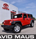 jeep wrangler unlimited 2010 red suv sport gasoline 6 cylinders 4 wheel drive 6 speed manual 32771