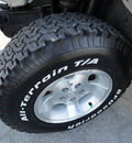 jeep wrangler 2001 white suv sahara gasoline 6 cylinders 4 wheel drive 5 speed manual 60915
