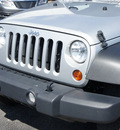 jeep wrangler unlimited 2012 silver suv sport gasoline 6 cylinders 4 wheel drive automatic 33021