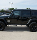 jeep wrangler unlimited 2012 black suv sport gasoline 6 cylinders 4 wheel drive automatic 76087