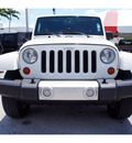 jeep wrangler unlimited 2010 white suv sahara gasoline 6 cylinders 4 wheel drive automatic 33157
