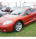 mitsubishi eclipse 2007 orange hatchback gs gasoline 4 cylinders front wheel drive automatic 77301