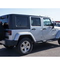jeep wrangler unlimited 2010 silver suv sahara gasoline 6 cylinders 4 wheel drive 6 speed manual 79065