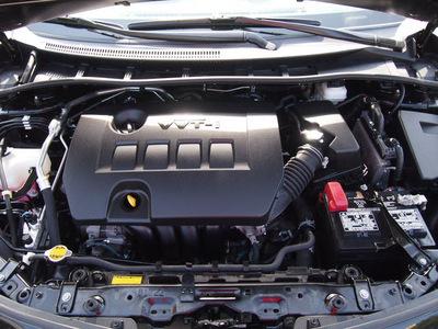 toyota corolla 2011 black sedan le gasoline 4 cylinders front wheel drive automatic 76011