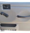 jeep wrangler 2003 beige suv rubicon gasoline 6 cylinders 4 wheel drive automatic 78130