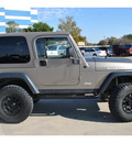 jeep wrangler 2003 beige suv rubicon gasoline 6 cylinders 4 wheel drive automatic 78130