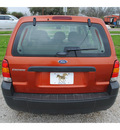 ford escape 2006 orange suv xls gasoline 4 cylinders all whee drive standard 77531