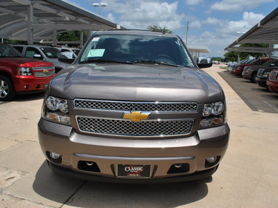 chevrolet tahoe 2013 brown suv lt flex fuel 8 cylinders 4 wheel drive automatic 76051
