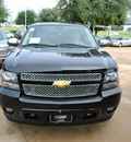 chevrolet suburban 2013 black suv lt flex fuel v8 2 wheel drive automatic 76051