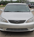 toyota camry 2005 silver sedan xle v6 gasoline 6 cylinders front wheel drive automatic with overdrive 77074