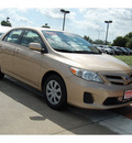 toyota corolla 2011 tan sedan le gasoline 4 cylinders front wheel drive automatic with overdrive 77706