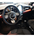 mini cooper 2009 chili redwhite top hatchback gasoline 4 cylinders front wheel drive 6 speed manual 78006